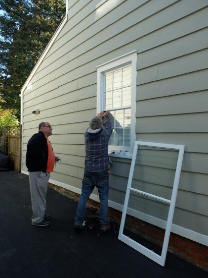 installing custom made storm window- cold spring ny