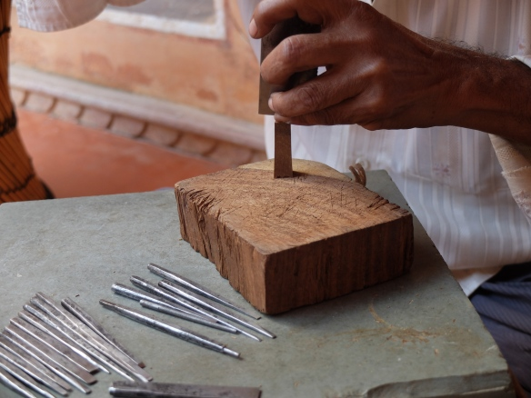 carving wood stamp for block printing
